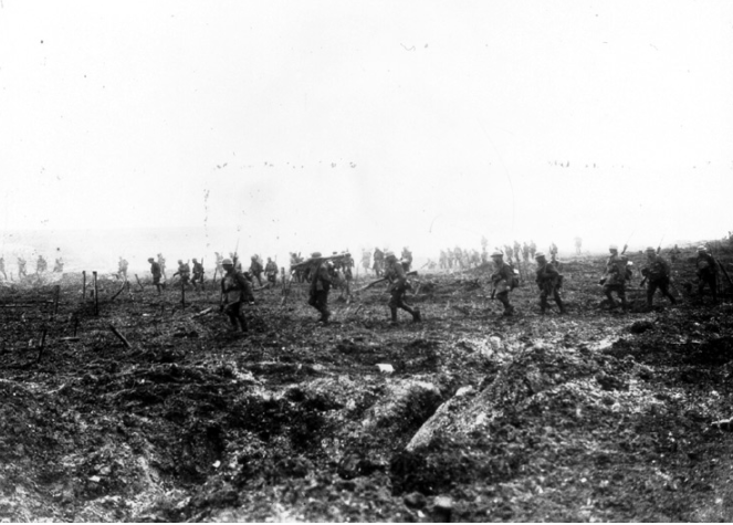"""29th Infantry Battalion advancing over """"No Man's Land"""" during the battle of Vimy Ridge. Dead comrades, or enemy, lay at left. (National Archive of Canada PA 1020)"""