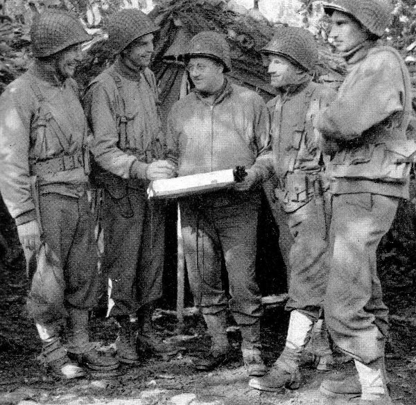 From left to right: Col. George A. Taylor, 16th Infantry commanding officer; Major Carl W. Plitt, S-3; Major Charles E. Tegtmeyer. Regimental Surgeon; Major John H. Lauten, S-2; and Captain William Friedman, S-1. Photo taken during amphibious exercise in England, early 1944.