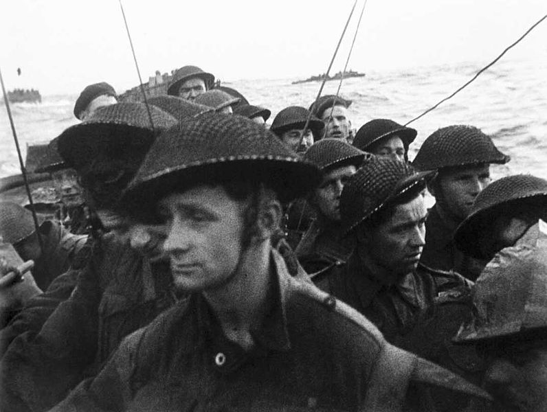 Film_still_from_the_D-Day_landings_showing_commandos_aboard_a_landing_craft_on_their_approach_to_Sword_Beach,_6_June_1944