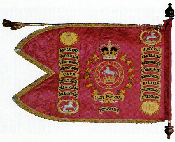 Guidon of the First Hussars. Emblazoned battle honors are South Africa 1900, Arras 1917, France and Flanders 1915-1918, Vimy 1917, Cambrai 1918, Hindenburg Line, Pursuit to Mons, Normandy Landing, Le Mesnil-Patry, Faubourg de Vaucelles, Caen, Verrieres Ridge-Tilly La Campagne, Falaise, Calais 1944, The Rhineland, The Lower Maas, Apeldoorn. At the center of the guidon is the First Hussars' motto: Hodie non cras (Today not tomorrow).